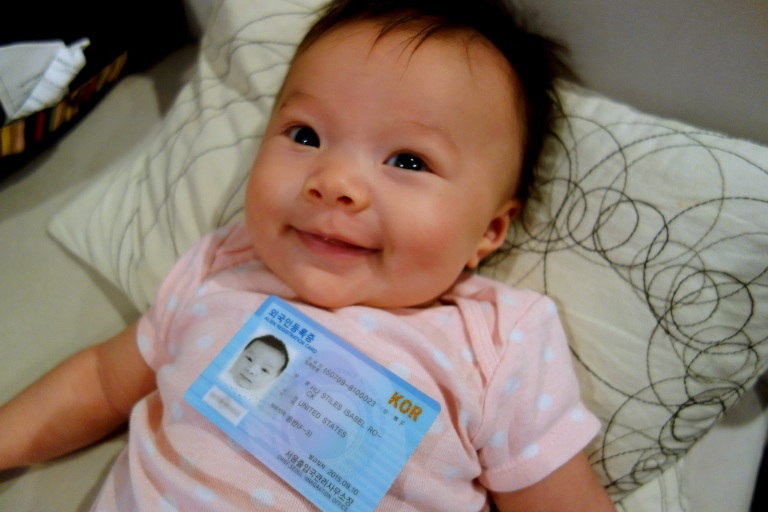 Isa and her alien registration card.