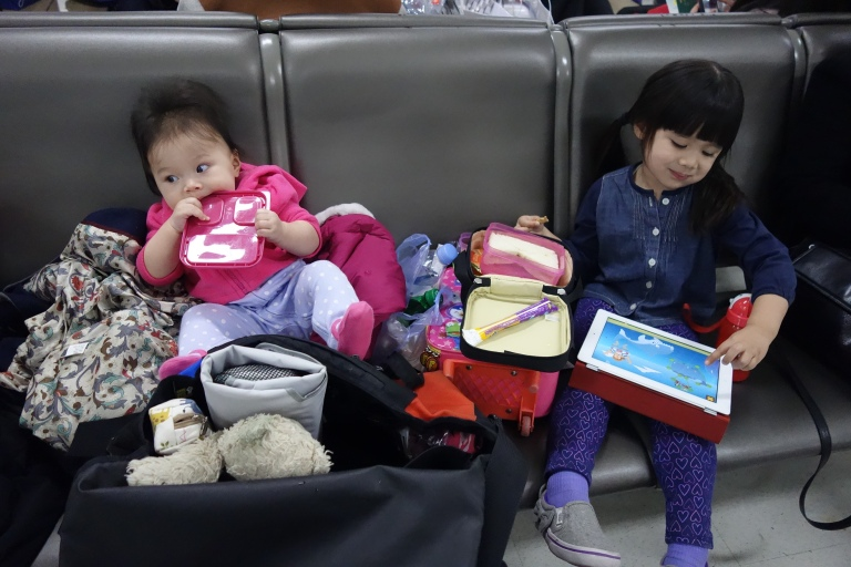 Isabel and sister Eva, waiting to board an evening flight.