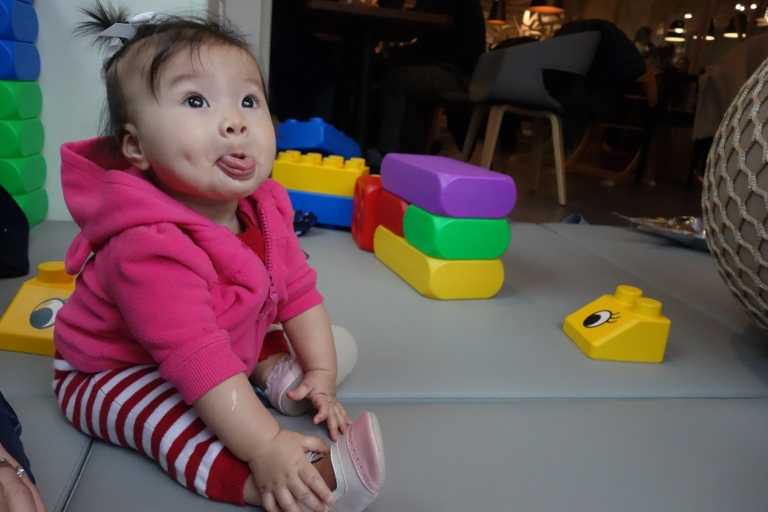 Another seven months milestone, besides sitting on her own, is blowing raspberries with her tongue out.