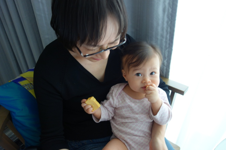 Oma feeds Isa her new favorite food, tamagoyaki. She eats about six pieces each day.