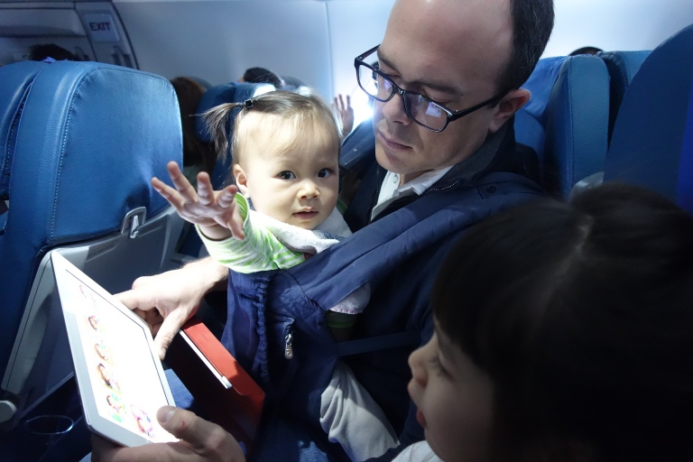 En route to the Philippines, Isa tried to sneak a look at what Eva and Dad were watching. But she got distracted by the camera.