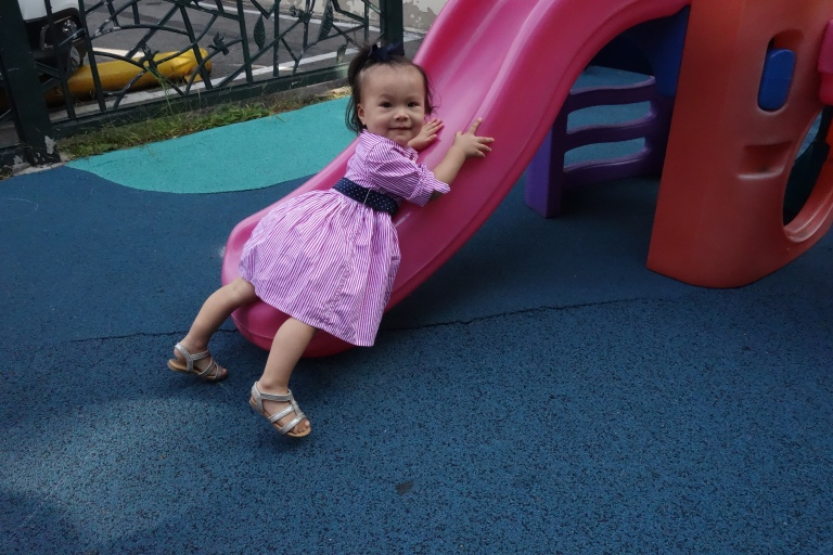 One of Isa's interests is climbing up a slide the wrong way.