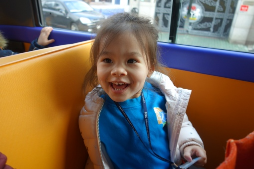 All smiles on the bus with mommies, daddies and nannies.