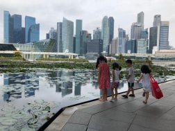 Playing with the other kids with the gorgeous Singapore skyline